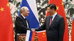 Le Président russe Vladimir Poutine (à gauche) et son homologue chinois, Xi Jinping - Photo AFP/How Hwee Young
