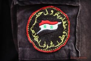 L'écusson de l'honneur, authentique badge cousu sur les uniformes de la VRAIE Protection Civile Syrienne à Alep-Ouest - Photo Vanessa Beeley, 15/08/2016